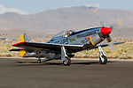 Stuart Eberhardt taxies his North American Aviation built P-51 Mustang &quot;Merlin's Magic&quot; along the ramp at Stead Field, Nevada. The Mustang is considered by many to be the premier fighter of World War II. Stuart has campaigned Merlin's Magic at the Reno National Championship Air Races regularly since purchasing the aircraft in 1986.  Photographed 09/07