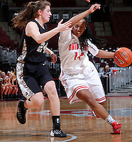 Ohio State Buckeyes guard Ameryst Alston (14) fends off Army Black Knights guard/forward Jean Parker (24) during the second half of Friday's NCAA Division I basketball game at Value City Arena in Columbus on December 13, 2013. Ohio State won the game 59-56. (Barbara J. Perenic/The Columbus Dispatch)