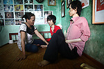 Tran Thi Hoa, 47, shares a quiet moment with her sons, 18-year-old La Thanh Nghia (left) and 21-year-old La Thanh Toan (right) at their home in Da Nang, Vietnam. The brothers are third generation victims of dioxin exposure, the result of the U.S. military's use of Agent Orange and other herbicides during the Vietnam War more than 40 years ago. They were born healthy, but began to suffer from muscular dystrophy and other problems as they grew older. They are now confined at home as their bodies and lives waste away. The Vietnam Red Cross estimates that 3 million Vietnamese suffer from illnesses related to dioxin exposure, including at least 150,000 people born with severe birth defects since the end of the war. The U.S. government is paying to clean up dioxin-contaminated soil at the Da Nang airport, which served as a major U.S. base during the conflict. But the U.S. government still denies that dioxin is to blame for widespread health problems in Vietnam and has never provided any money specifically to help the country's Agent Orange victims. Jan. 5, 2013.