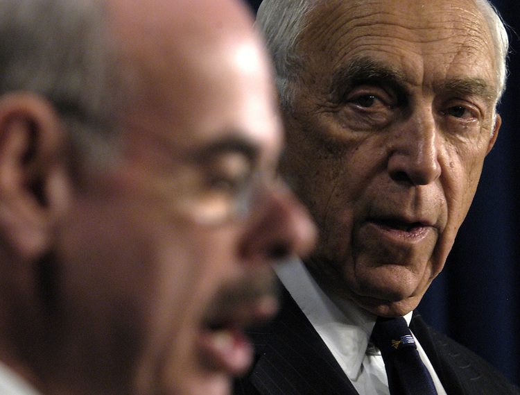 Sen. Frank Lautenburg, D-NJ, watches Rep. Henry Waxman, D-Ca., at a press conference on Iraqi war profiteering with gas and business contracts.