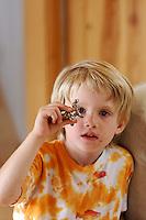 Eno Little plays with a miniature Hanuman murti