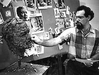 Robert Barks, sculpting Ernest Hemingway's head working from a picture taken by Ken Heyman.