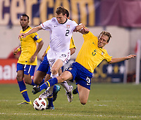 Jonathan Spector (2) of the USMNT has the ball tackled away from him by Lucas (5) of Brazil during an international friendly at the New Meadowlands Stadium in East Rutherford, NJ. Brazil defeated the USMNT, 2-0.
