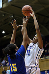 30 October 2014: Duke's Azura Stevens (11) shoots over Limestone's Celestra Warren (15). The Duke University Blue Devils hosted the Limestone College Saints at Cameron Indoor Stadium in Durham, North Carolina in an NCAA Women's Basketball exhibition game. Duke won the game 100-33.