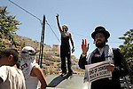 An ultra-orthodox Jew from 'Neturei Karta', a Haredi sect opposing Zionism and the state of Israel, protests alongside Palestinians after Israeli rightwing activists have marched in defiance in the Palestinian village of Silwan, east Jerusalem.