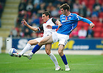St Johnstone v Inverness Caley Thistle...15.10.11   SPL Week 11.Cillian Sheridan battles with Thomas Piermayr.Picture by Graeme Hart..Copyright Perthshire Picture Agency.Tel: 01738 623350  Mobile: 07990 594431