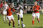 14 December 2007: Wake Forest's Marcus Tracy (9) is defended by Virginia Tech's James Shupp (4) and Ben Nason (14). The Wake Forest University Demon Deacons defeated the Virginia Tech University Hokies 2-0 at SAS Stadium in Cary, North Carolina in a NCAA Division I Men's College Cup semifinal game.