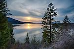 Idaho, Northern, Kootenai County, Hayden. Hayden Lake under hazy evening skies in spring.