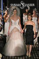 fashion designer Sarah Jassir, walks runway with model at the close of her Sarah Jassir Fall 2011 - Desire bridal collection.