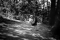Elizabeth spends endless hours swinging on the tire swing in the family's back yard.