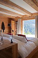 The centrally placed double bed in the contemporary bedroom has views of Mont Blanc through a picture window
