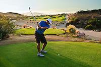 Golfer putting, Palmilla Golf Course, San Jose del Cabo, Baja California Sur, Mexico