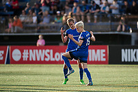 Seattle, WA - Sunday, May 21, 2017: Beverly Yanez and Megan Rapinoe during a regular season National Women's Soccer League (NWSL) match between the Seattle Reign FC and the Orlando Pride at Memorial Stadium.