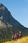 Four women run along trails in the Canadian Rockies on a late summer morning in Canmore Alberta, Canada.  Photo by Gus Curtis.