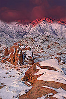 711700248 sunrise lights up the eastern sierras with pink alpenglow on a winter morning in the alabama hills on blm protected lands in central california