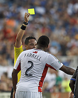 Yellow Card: New England Revolution defender Andrew Farrell (2) from Jose Carlos Rivero. In a Major League Soccer (MLS) match, the New England Revolution (white) defeated San Jose Earthquakes (black), 2-0, at Gillette Stadium on July 6, 2013.