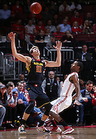 Maryland Terrapins guard/forward Jake Layman (10) almost loses the ball under pressure from Ohio State Buckeyes forward Sam Thompson (12) in the first half of the college basketball game between the Ohio State Buckeyes and the Maryland Terrapins at the Jerome Schottenstein Center in Columbus, Wednesday evening, December 4, 2013. As of half time the Ohio State Buckeyes led the Maryland Terrapins 43 - 26. (The Columbus Dispatch / Eamon Queeney)