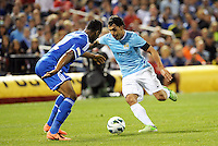 Carlos Tevez (32) Manchester City faces Mikel Chelsea..Manchester City defeated Chelsea 4-3 in an international friendly at Busch Stadium, St Louis, Missouri.