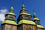 Ancient wooden orthodox church house under blue clear sky Ukraine Eastern Europe