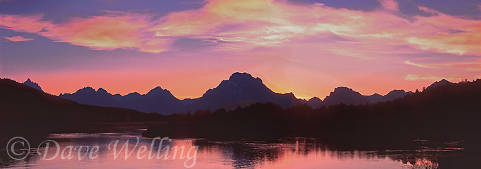 937000007 panoramic view of the teton range backlit by the setting sun at oxbow bend of the snake river in grand tetons national park wyoming