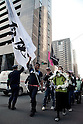 March 11, 2012, Tokyo, Japan - At the front of the rally a white flag and a funeral wreath against nuclear energy and also to commemorate the first anniversary of the Great East Japan Earthquake. Many protesters carrying banners took to the streets of Tokyo to demonstrate against nuclear power on the first anniversary of the Great East Japan Earthquake. (Photo by Rodrigo Reyes Marin/AFLO) (JAPAN)