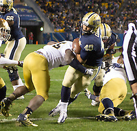 Pitt running back James Conner (40) scores on a one yard touchdown run. The Pittsburgh Panthers defeated the Notre Dame Fighting Irish 28-21 at Heinz Field, Pittsburgh, Pennsylvania on November 9, 2013.