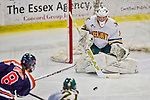 4 January 2014:  University of Vermont Catamount goaltender Roxanne Douville, a Senior from Beloeil, Quebec, in action against the Syracuse University Orange, in non-conference play at Gutterson Fieldhouse in Burlington, Vermont. The Orange defeated the UVM Lady Cats 4-3 in their first ever NCAA meeting. Mandatory Credit: Ed Wolfstein Photo *** RAW (NEF) Image File Available ***