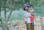 A woman and child in the Cambodian village of Pheakdei.