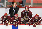Edwin Shea (BC - 8), Greg Brown (BC - Assistant Coach), Tommy Cross (BC - 4), Carl Sneep (BC - 7), Brian Dumoulin (BC - 2) - The Boston College Eagles defeated the Harvard University Crimson 3-2 on Wednesday, December 9, 2009, at Bright Hockey Center in Cambridge, Massachusetts.