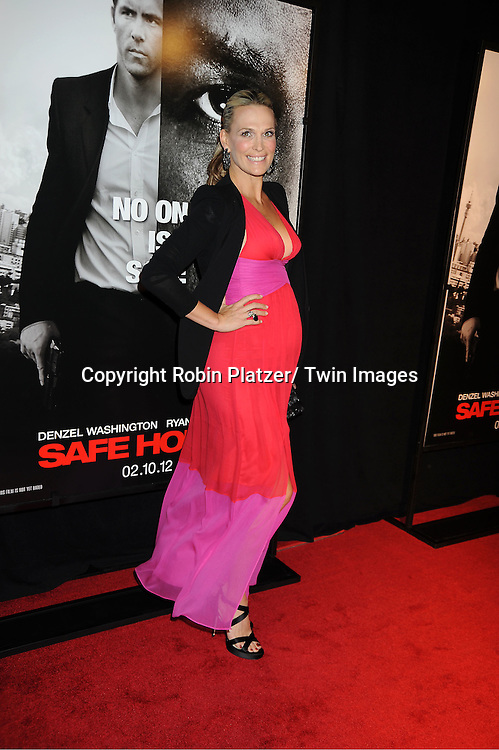 """Molly Sims arrives for the World Premiere of """" Safe House""""  on February 7, 2012 at The School of Visual Arts Theatre in New York City. Denzel Washington, Ryan Reynolds, Vera Farmiga and Robert Patrick star in the movie."""