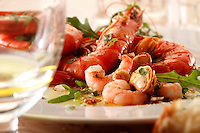 Seafood salad with Whole prawns & mussels on a white plate