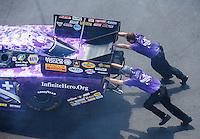 Aug 21, 2016; Brainerd, MN, USA; Crew members push the car of NHRA  funny car driver Jack Beckman during the Lucas Oil Nationals at Brainerd International Raceway. Mandatory Credit: Mark J. Rebilas-USA TODAY Sports