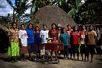 Women from a remote village outside Wamena stand beside the sewing machine donated by the 'Twin Teachers' Rian and Rossy. The trials and tribulations of the twin sisters' crusade has not deterred their passion for work. Instead, they have expanded to various parts of the country promoting training modules to gain practical skills as part of their adult education programme targeting women empowerment. Since the early 1990s, twin sisters Sri Rosyati (known as Rossy) and Sri Irianingsih (known as Rian) have used their family inheritance to set up and run 64 schools in different parts of Indonesia, providing primary education combined with practical skills to some of the country's most deprived children.   .
