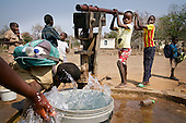Children at a primary school in drought-hit Masvingo Province, Zimbabwe, collect water from a borehole.  <br /> <br /> Drought in southern Africa is devastating communities in Zimbabwe, leaving 4 million people urgently in need of food aid. The government declared a state of emergency,. <br /> <br /> Here in Masvingo Province, the country's hardest hit province, vegetation has wilted, livestock is dying, and people are at serious risk of famine. <br /> <br /> Pictures shot by Justin Jin