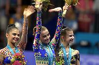 Oct 01, 2000; SYDNEY, AUSTRALIA:<br /> (L-R)Alina Kabaeva (RUS) bronze, Yulia Barsoukova (RUS) gold, Yulia Raskina (BLR) silver medal,  celebrate during rhythmic gymnastics medals ceremony at 2000 Summer Olympics.