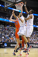 The Huskies' Charles Okwandu tips the ball in for two points. Connecticut defeated Bucknell 81-52 during the NCAA tournament at the Verizon Center in Washington, D.C. on Thursday, March 17, 2011. Alan P. Santos/DC Sports Box