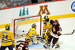 09 APR 2011: Kyle Schmidt (7) of University of Minnesota, Duluth celebrates his game-winning, over-time goal against the University of Michigan during the Division I Men's Ice Hockey Championship held at the Xcel Energy Center in St. Paul, MN.  Minnesota-Duluth beat Michigan in overtime, 3-2 to claim the national title. Vince Muzik/NCAA Photos
