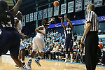 14 November 2012: Georgetown's Sugar Rodgers (14) shoots over North Carolina's Xylina McDaniel. The University of North Carolina Tar Heels played the Georgetown University Hoyas at Carmichael Arena in Chapel Hill, North Carolina in an NCAA Division I Women's Basketball game, and a semifinal in the Preseason WNIT. UNC won the game 63-48.