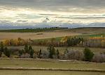 Idaho, Eastern, The majestic Teton Range peaks between the clouds on an autumn morning.