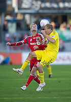 16 October 2010: Columbus Crew forward Steven Lenhart #32 and Toronto FC defender Raivis Hscanovics #34 in action  during a game between the Columbus Crew and Toronto FC at BMO Field in Toronto..The game ended in a 2-2 draw.