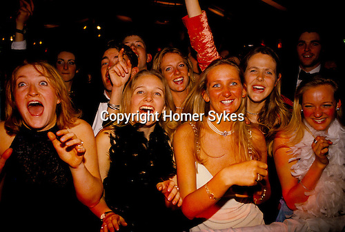 LAUGHING FEMALE REVELLERS AT THE ROYAL AGRICULTURAL COLLEGE BALL, CIRENCESTER, GLOUCESTERSHIRE,