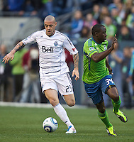 Vancouver Whitecaps FC  forward Eric Hassli changes direction on Seattle Sounders FC defender Jhon Kennedy Hurtado  during play at Qwest Field in Seattle Saturday June 11, 2011. The game ended in a 2-2 draw.