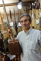 Kanaya brush shop manager Hideo Ohuchi, Asakusa, Tokyo, Japan, August 28, 2011. Sensoji is one of the oldest temples in Tokyo, and the shopping arcades around it have sold visitors souvenirs for centuries.