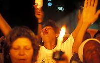 Rio de Janeiro, Brazil. Ecumenical cult for peace. Demonstration against violence. Relatives of violence victims pray together. Citizenship and religious fervour.