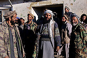 Maidan Shaher, Afghanistan<br /> November 24, 2001<br /> <br /> The Taliban receive the Northern Alliance and journalist into the district of Maidan Shaher after a truce is struck between the two forces. Just two days ago the two fractions fought each other in a serious battle over the territory.