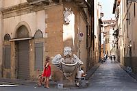 Piazza de' Frescobaldi, on the angle of Via Borgo San Jacopo and Via dello Sprone in the Altrarno district of Florence near 9Rosso boutique