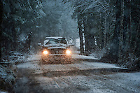 Car driving in a snowstorm, Sitka, Alaska, USA