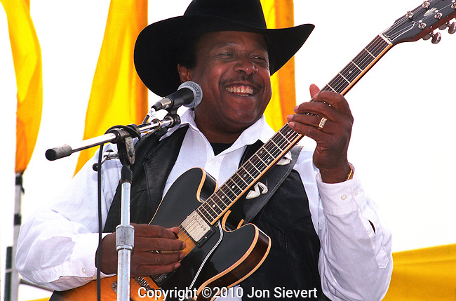 """Lonnie Brooks, 9/19/99.San Francisco Blues Festival. American blues singer and guitarist. Rolling Stone says, """"His music is witty, soulful and ferociously energetic, brimming with novel harmonic turnarounds, committed vocals and simply astonishing guitar work."""" ''The New York Times'' adds, """"He sings in a rowdy baritone, sliding and rasping in songs that celebrate lust, fulfilled and unfulfilled; his guitar solos are pointed and unhurried, with a tone that slices cleanly across the beat. Wearing a cowboy hat, he looks like the embodiment of a good-time bluesman."""""""
