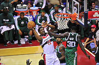 Kevin Seraphin of the Wizards gets a bucket against Celtic's Brandon Bass. Boston defeated Washington 89-86 at the Verizon Center in Washington, D.C. on Saturday, November 3, 2012.  Alan P. Santos/DC Sports Box