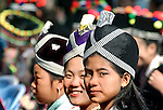 Hmong girls wearing traditional headdress during the Hmong New Year celebrations at Luang Prabang, Laos.